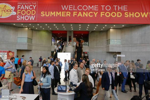 People attend the annual Summer Fancy Food Show at the Javitz Center on June 26 2017 in New York City