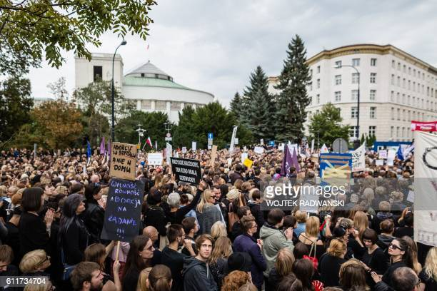 People attend the antigovernment proabortion demonstration in front of Polish Pariament in Warsaw Poland on October 1 2016 / AFP / AFP PHOTO / WOJTEK...