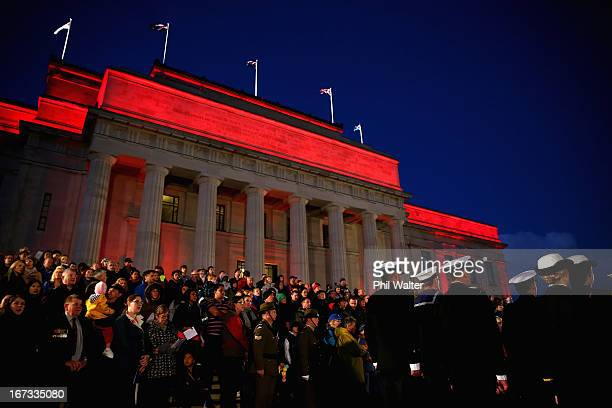 People attend the ANZAC Day dawn service at the Auckland War Memorial Museum on April 25 2013 in Auckland New Zealand Veterans dignitaries and...