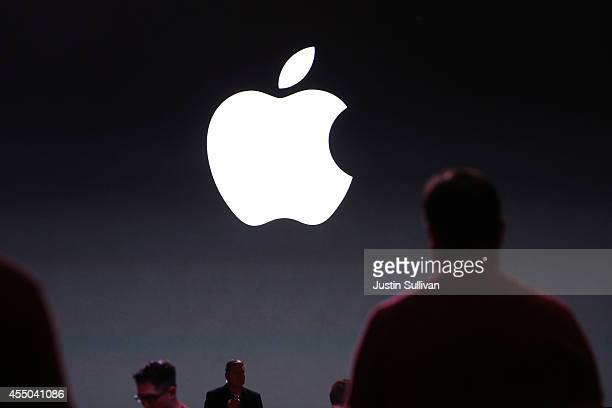 People attend the Apple keynote at the Flint Center for the Performing Arts at De Anza College on September 9 2014 in Cupertino California Apple is...