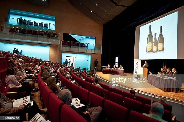People attend the auction of a bottles of champagne found on the bottom of the Baltic in Mariehamn Aland on June 8 2012 A 200yearold bottle of Veuve...