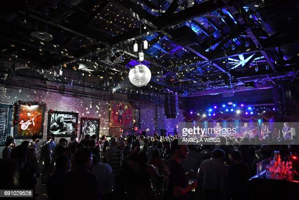 People attend the auction of Jerry Garcia's guitar on May 31 2017 in Brooklyn New York A guitar of Grateful Dead legend Jerry Garcia raised more than...