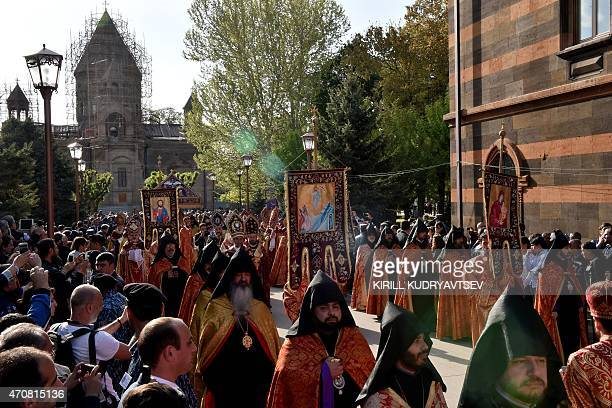 People attend the canonization ceremony for the victims of the Armenian Genocide in Echmiadzin outside Yerevan on April 23 2015 Armenians prepare to...