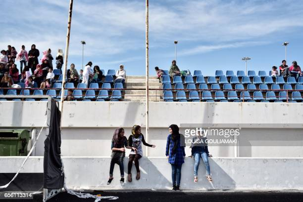 People attend the celebrations of Nowruz the Persian New Year on March 21 2017 at the Hockey refugee camp situated at the former Olympic Complex in a...