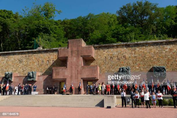 People attend the ceremony to mark the 77th anniversary of late French General Charles de Gaulle's appeal of June 18 at the Mont Valerien memorial in...