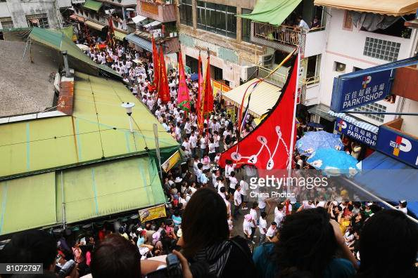 People attend the Cheung Chau Bun Festival Grand Parade at Cheung Chau Island on May 12 2008 in Hong Kong China The Cheung Chau Bun Festival is an...