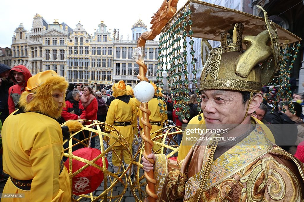 People attend the Chinese Lunar New Year parade in Brussels, on February 6, 2016. Chinese are celebrating the Lunar New Year, which marks the beginning of the Year of the Monkey. / AFP / BELGA / NICOLAS MAETERLINCK / Belgium OUT