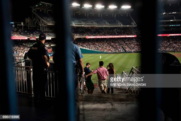 People attend the Congressional Baseball Game between Democrats and Republicans at Nationals Stadium June 15 2017 in Washington DC This year's...