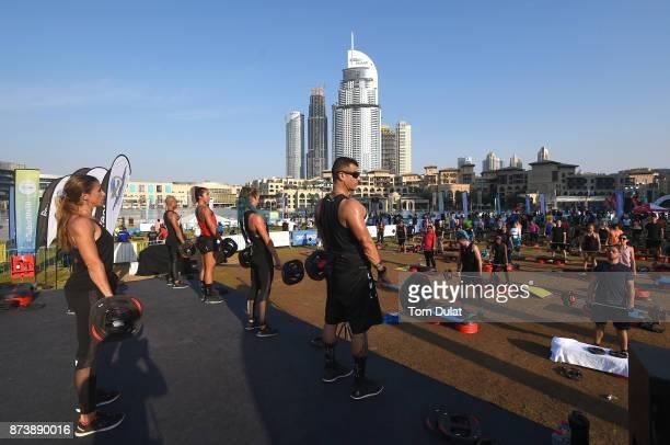 People attend the Dubai Fitness Challenge at Burj Park on November 10 2017 in Dubai United Arab EmiratesThe Mobile Fitness unit offers halfhour...