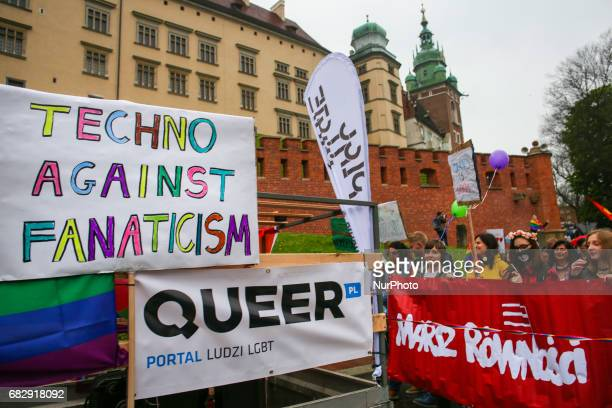 People attend the Equality March in Krakow Poland on 13 May 2017 Lesbians gays bisexual transgender and queer persons together with their families...