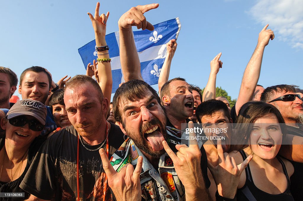 People attend the Eurockeennes music festival on July 7, 2013 in the French eastern city of Belfort.
