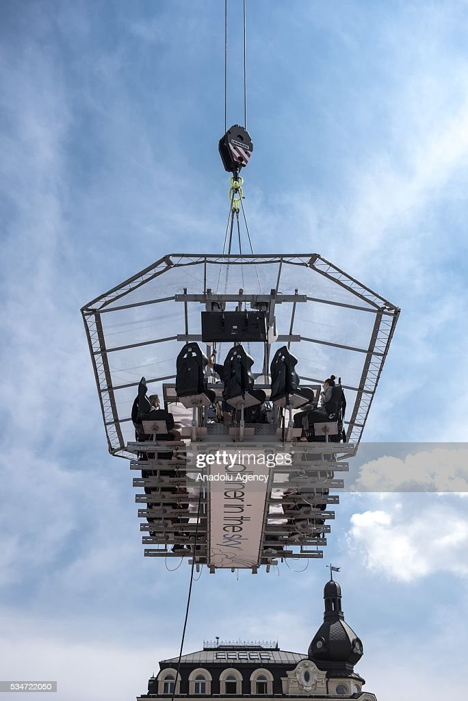 People attend the event Dinner in the Sky at the Plac Jezioranskiego, Krakow, Poland on MAY 27, 2016. Dinner In The Sky is sunique event and takes place at a table suspended at a height of 50 meters above the ground. Dinner in the Sky is a prestigious event which has been recognized in more than 30 countries such as the United States, Canada, England, France, Portugal and others.