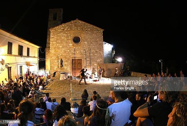 People attend the 'Festa del Borgo' the medieval fair held every year in the village of Roccatederighi on August 10 2013 in Grosseto Italy