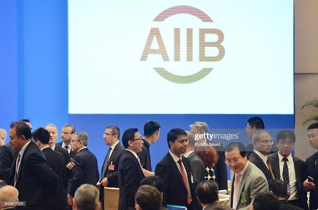People attend the first annual meeting of the Asian Infrastructure Investment Bank in Beijing on June 25, 2016. The Chinese-backed development bank said it has approved financing for its first four projects worth about $500 million in total.
