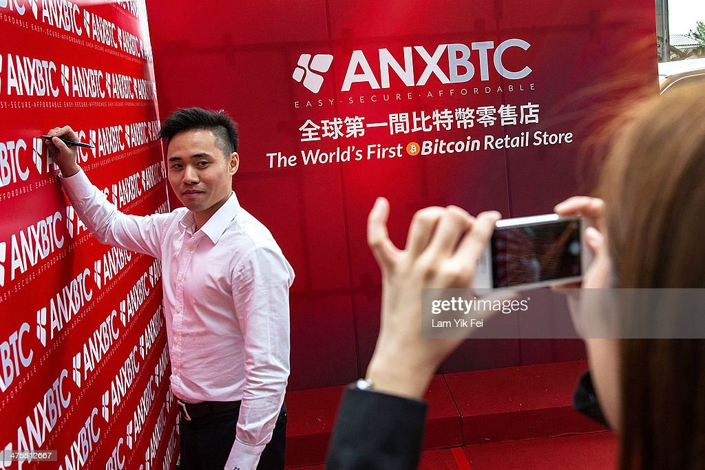 People attend the first bitcoin retail store open in Hong Kong on February 28, 2014 in Hong Kong. Asia Nexgen, a Hong Kong based bitcoin exchange has launched a physical store enabling customers to purchase bitcoin and store it in their digital bitcoin wallets. Bitcoin Group HK and Hong Kong Bitcoin ATM plan to launch bitcoin 'ATM's machines in the area. in 2008 Bitcoin was launched as an alternative currency, with the commodity boasting the ability to be transferred without the need of the traditional monetary banking system.