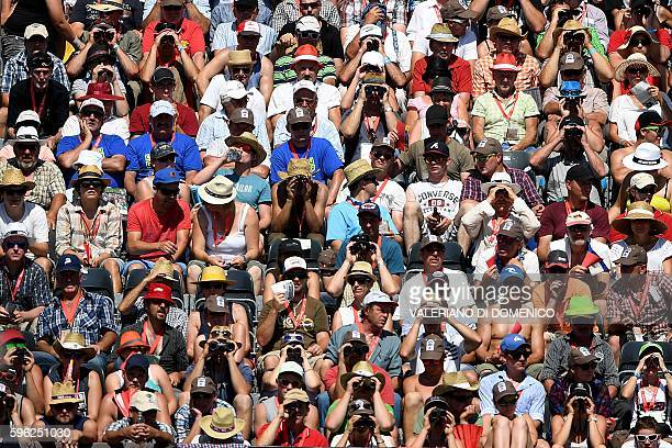 People attend the first day of the Federal Alpine Wrestling Festival on August 27 2016 in Payerne western Switzerland More than 200000 spectators are...