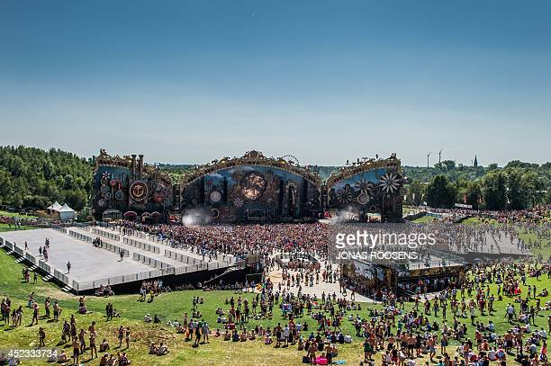 People attend the first day of the Tomorrowland electronic music festival in Boom Belgium on July 18 2014 The 10th edition of Tomorrowland electronic...