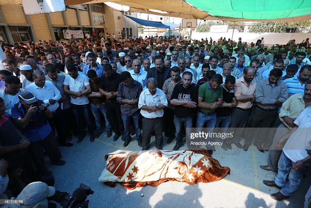 People attend the funeral ceremony of Riham Dawabsheh the mother of an 18monthold Palestinian boy who burnt to death in a July arson attack by...