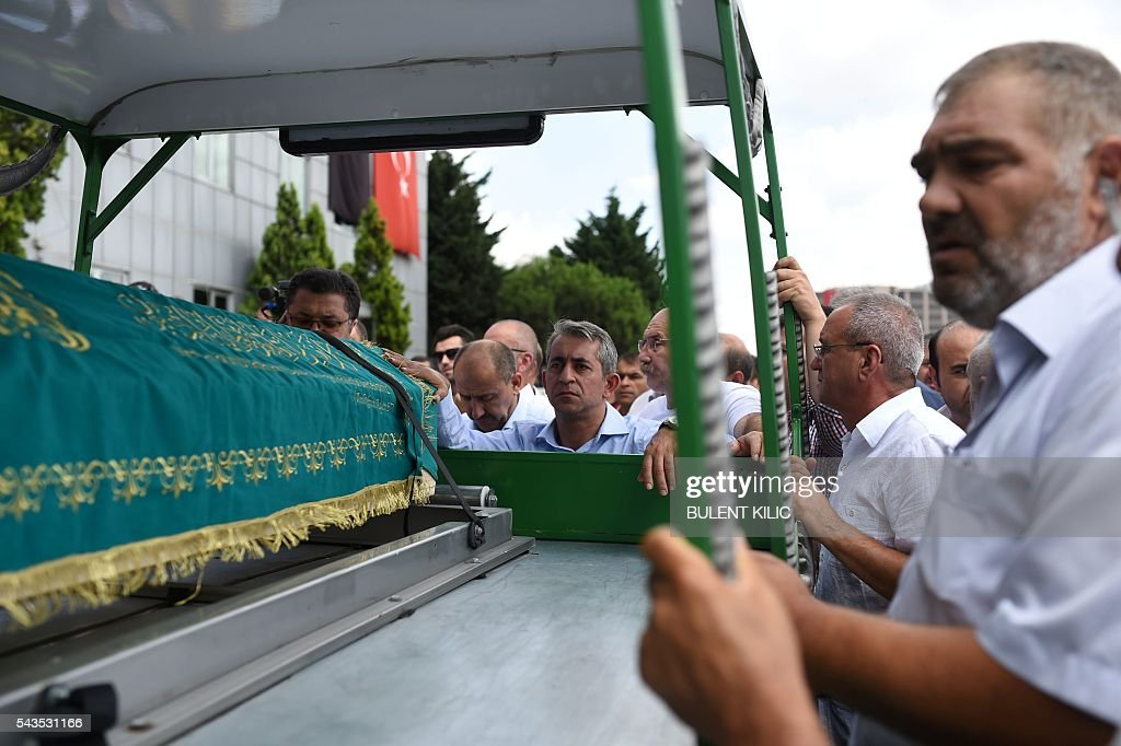 People attend the funeral ceremony of taxi driver Mustafa Biyikli who was killed in the June 28, 2016 airport attack, on June 29, 2016 in Istanbul, a day after a suicide bombing and gun attack targeted Istanbul's airport, killing at least 41 people. Turkey declared on June 29, 2016 a day of national mourning over a deadly attack at Istanbul's international airport blamed by the government on Islamic State jihadists. / AFP / BULENT