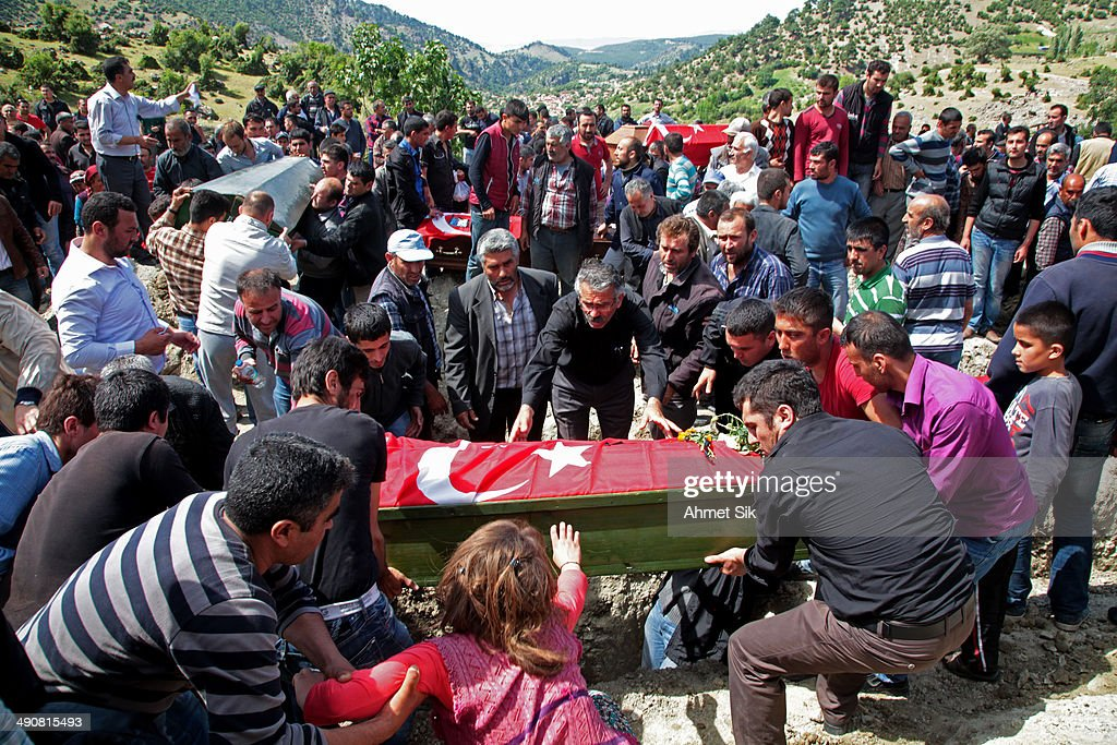 People attend the funeral of a miner who died in a fire at a coal mine at a cemetary on May 15 2014 in Soma a district in Turkey's western province...