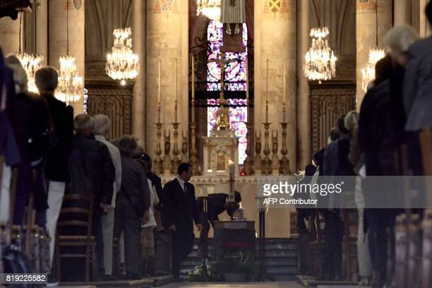 People attend the funeral of French judge JeanMichel Lambert at the SaintJulien Cathedral in Le Mans northwestern France on July 20 2017 Lambert who...