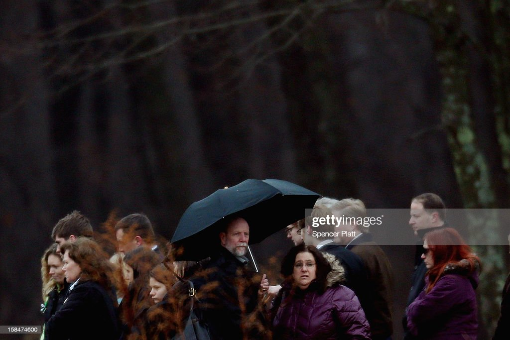 People attend the funeral services for six year-old Noah Pozner, who was killed in the shooting massacre in Newtown, CT, at B'nai Israel Cemetery on December 17, 2012 in Monroe, Connecticut. Today is the first day of funerals for some of the twenty children and seven adults who were killed by 20-year-old Adam Lanza on December 14, 2012.