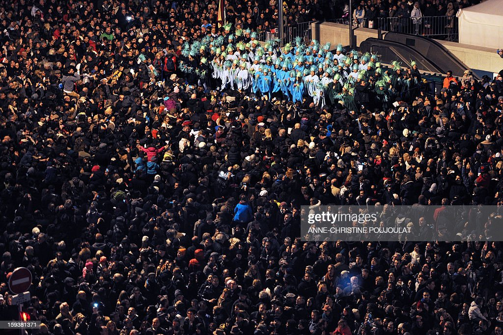 People attend the 'Grande Clameur', the ceremony launching festivities for the Marseille-Provence 2013 European Capital of Culture year, in Marseille on January 12, 2013. The event marks the start of a year, leading to a cultural renaissance in France's second-largest metropolitan area.