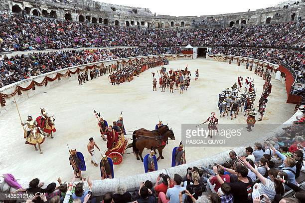 ZAKA People attend the Great Roman Games show in the amphitheatre on April 28 2012 in Nimes southern France This event is a historical evocation of...
