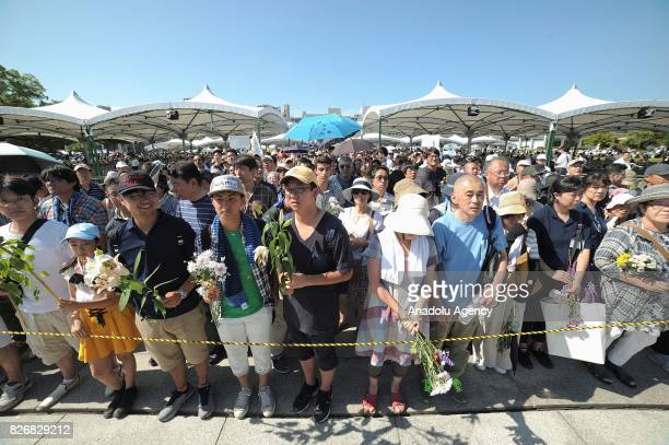 People attend the Hiroshima Peace Memorial Ceremony at the Hiroshima Peace Memorial Park on August 6 2017 in Hiroshima Japan Japan marks the 72nd...