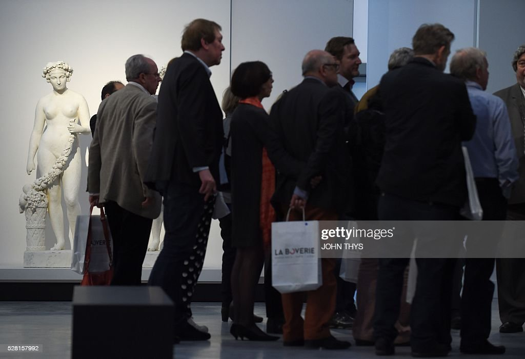 People attend the inauguration of the La Boverie museum on May 4, 2016 in Liege. The new museum La Boverie was inaugurated today, with an exhibition organised in partnership with Le Louvre museum. / AFP / JOHN