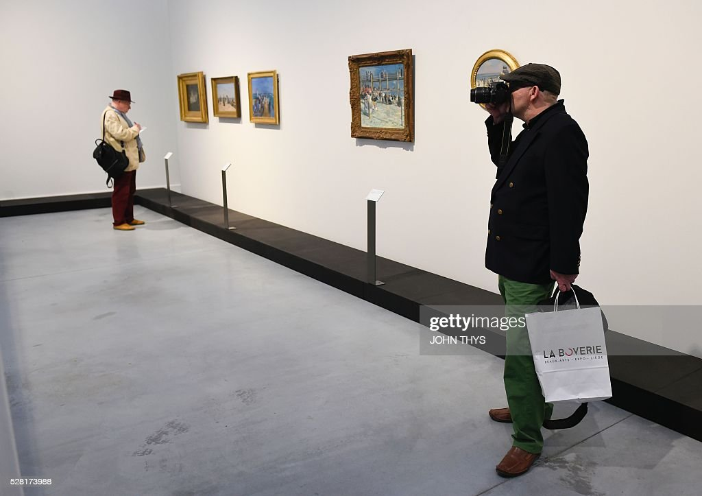 People attend the inauguration of the La Boverie museum on May 4, 2016 in Liege. The new museum La Boverie was inaugurated today, with the exhibition 'En Plein Air' (In The Open Air) organised in partnership with Le Louvre museum. / AFP / JOHN