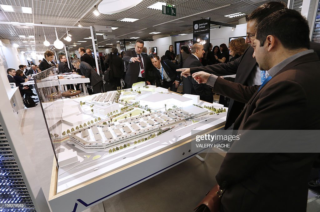 People attend the International Market for Retail Real Estate (MAPIC) on November 14, 2012 in the southeastern French city of Cannes. The event held until November 16, gathers thousands of retailers, investors, local and regional authorities, and retail property professionnals from around the world.
