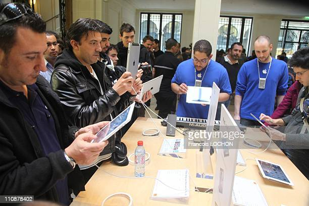 People attend the Ipad 2 launch in the Apple store in Opera Square on March 25 2011 in Paris France Apple fans gathered for a chance to be among the...
