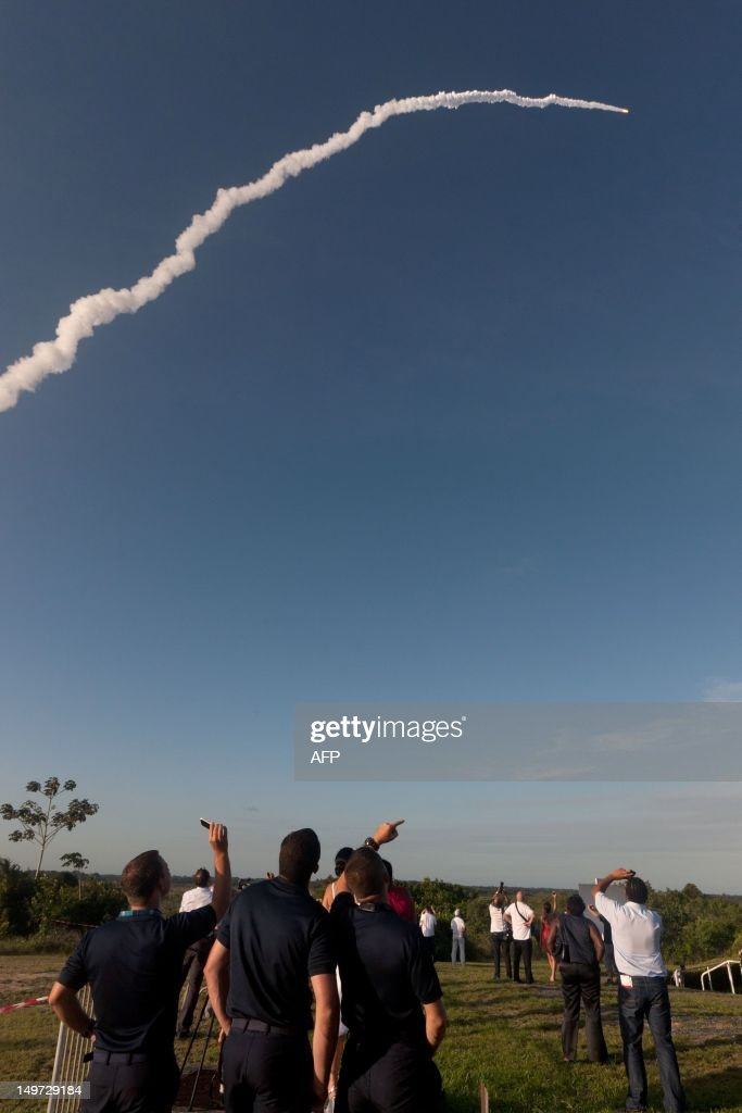 People attend the launch of an Ariane-5 rocket, carrying two telecommunication satellites and blasting off from the European space centre of Kourou, French Guiana on August 2, 2012. It will eventually place into orbit two geostationary telecommunication satellites -- Intelsat-20 for international satellite operator Intelsat, and HYLAS 2 for European operator Avanti Communications. Intelsat-20, which weighs more than six tonnes, will provide a large number of telecommunication, video, telephone and data transmission services in Europe, the Middle East, Russia and Asia. AFP PHOTO JEROME VALLETTE