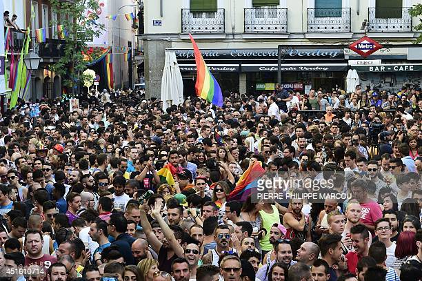 People attend the launch of the Gay Pride in Madrid on July 2 2014 AFP PHOTO / PIERREPHILIPPE MARCOU