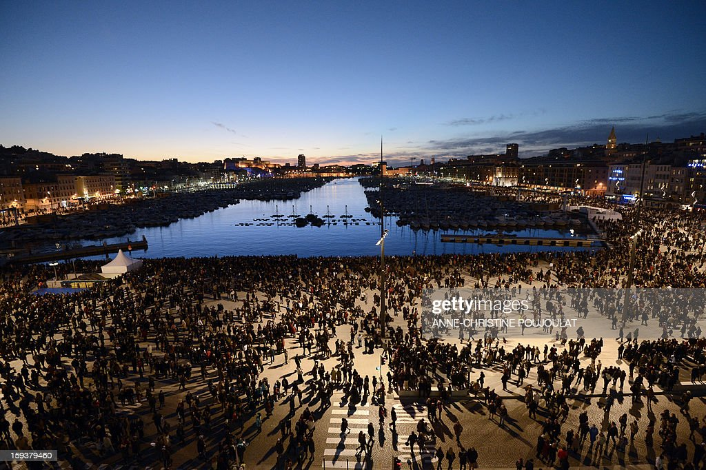 People attend the light parade in front of the Vieux-Port harbour on January 12, 2013 in the French southern city of Marseille, during the light parade, part of the launching of Marseille-Provence 2013 European Capital of Culture. The event marks the start of a year, leading to a cultural renaissance in France's second-largest metropolitan area.