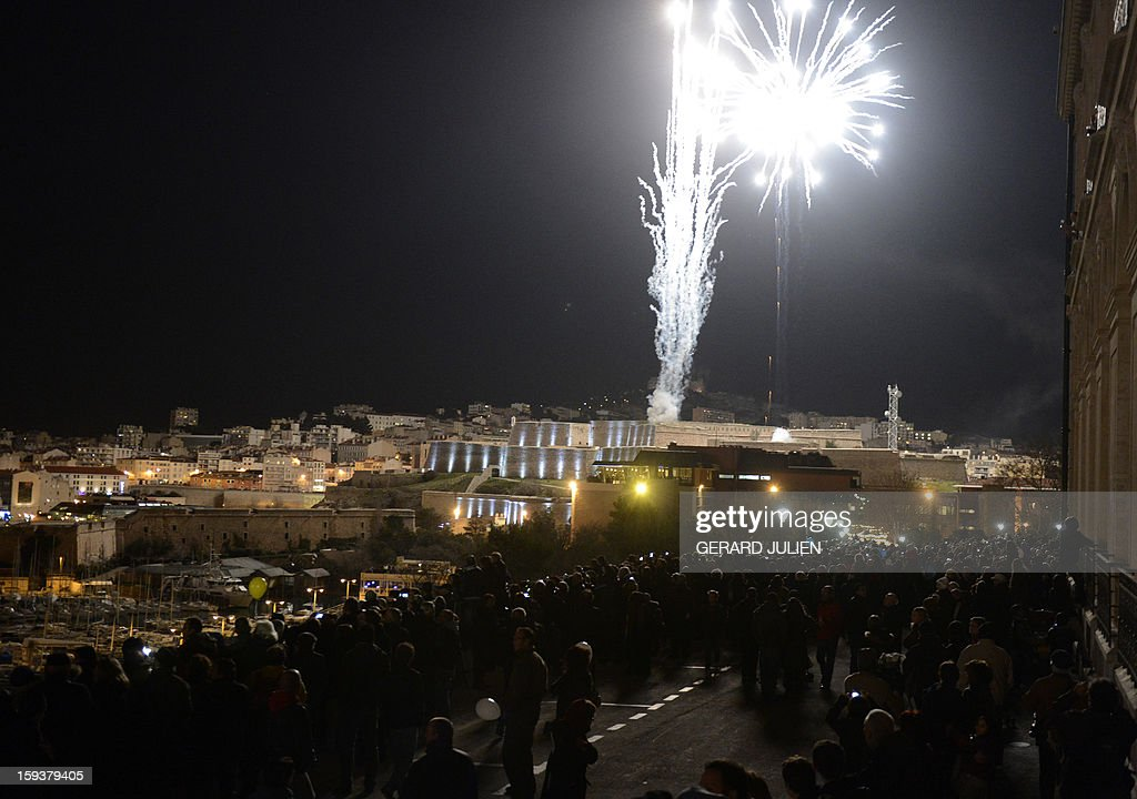People attend the light parade near the Vieux-Port harbour on January 12, 2013 in the French southern city of Marseille, during the light parade, part of the launching of Marseille-Provence 2013 European Capital of Culture. The event marks the start of a year, leading to a cultural renaissance in France's second-largest metropolitan area.