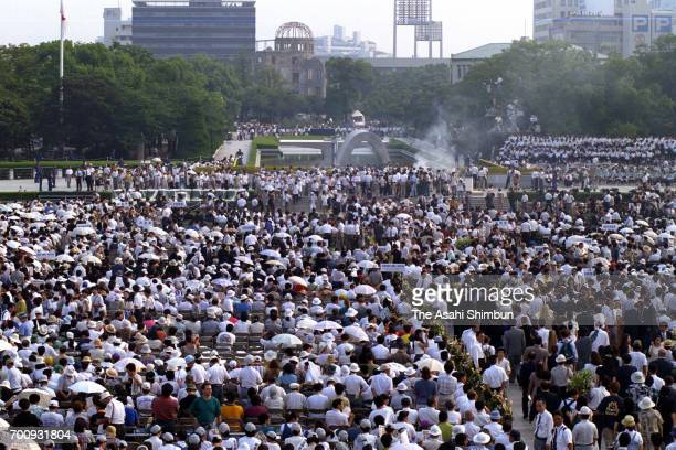 People attend the memorial ceremony on the 50th anniversary of the atomic bomb dropped at Hiroshima Peace Memorial Park on August 6 1995 in Hiroshima...