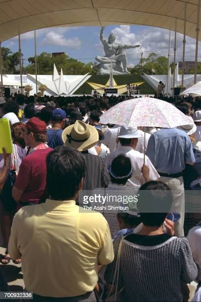 People attend the memorial ceremony on the 50th anniversary of the Nagasaki Abomb dropping at the Peace Park on August 9 1995 in Nagasaki Japan