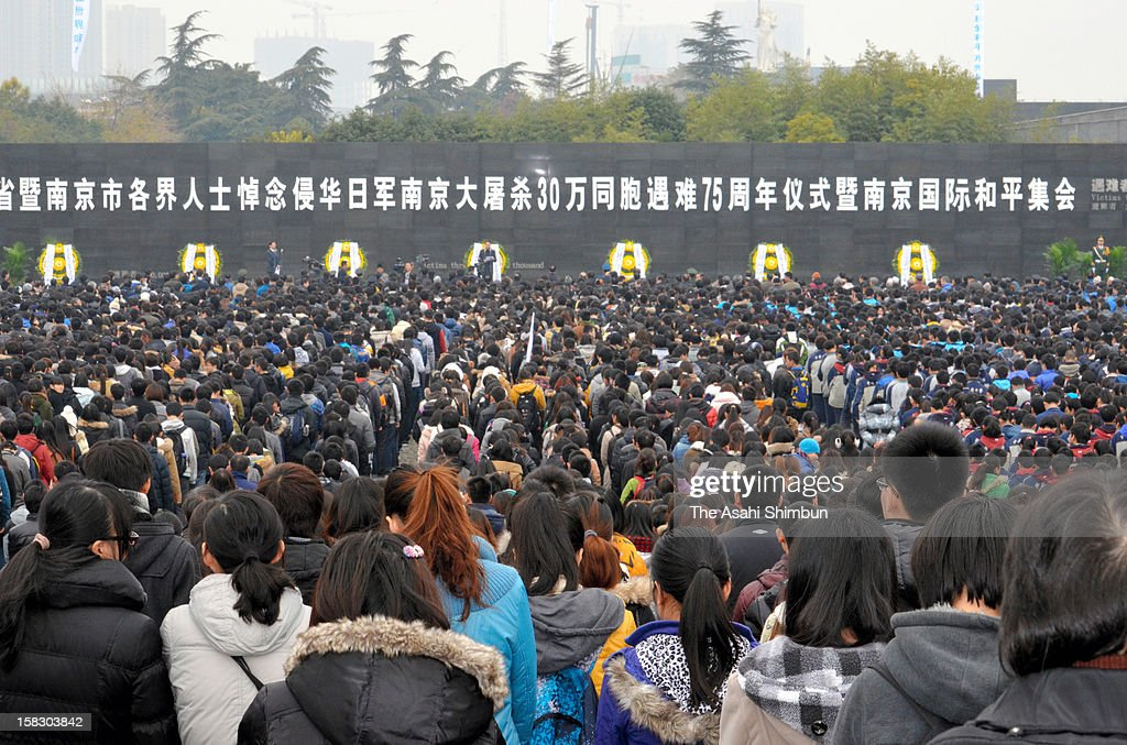 People attend the memorial ceremony to mark 75th anniversary of Nanjing (Nanking) Massacre on December 13, 2012 in Nanjing, China.