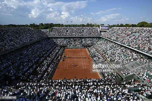 People attend the men's semifinal match Great Britain's Andy Murray vs Serbia's Novak Djokovic at the Roland Garros 2015 French Tennis Open in Paris...
