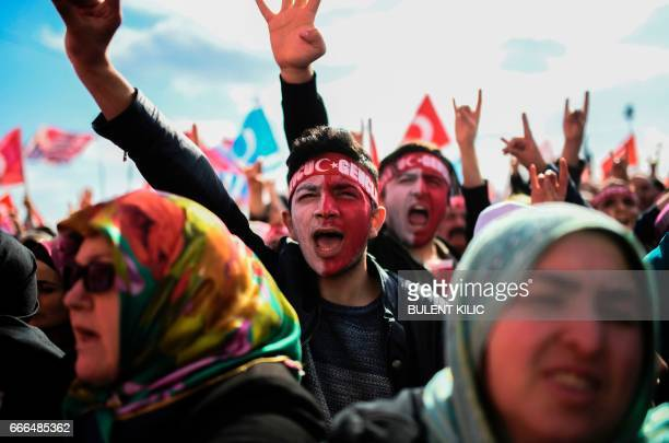 People attend the Nationalist Movement Party's meeting on April 9 2017 during a campaign rally for the 'yes' vote in a Turkish constitutional...