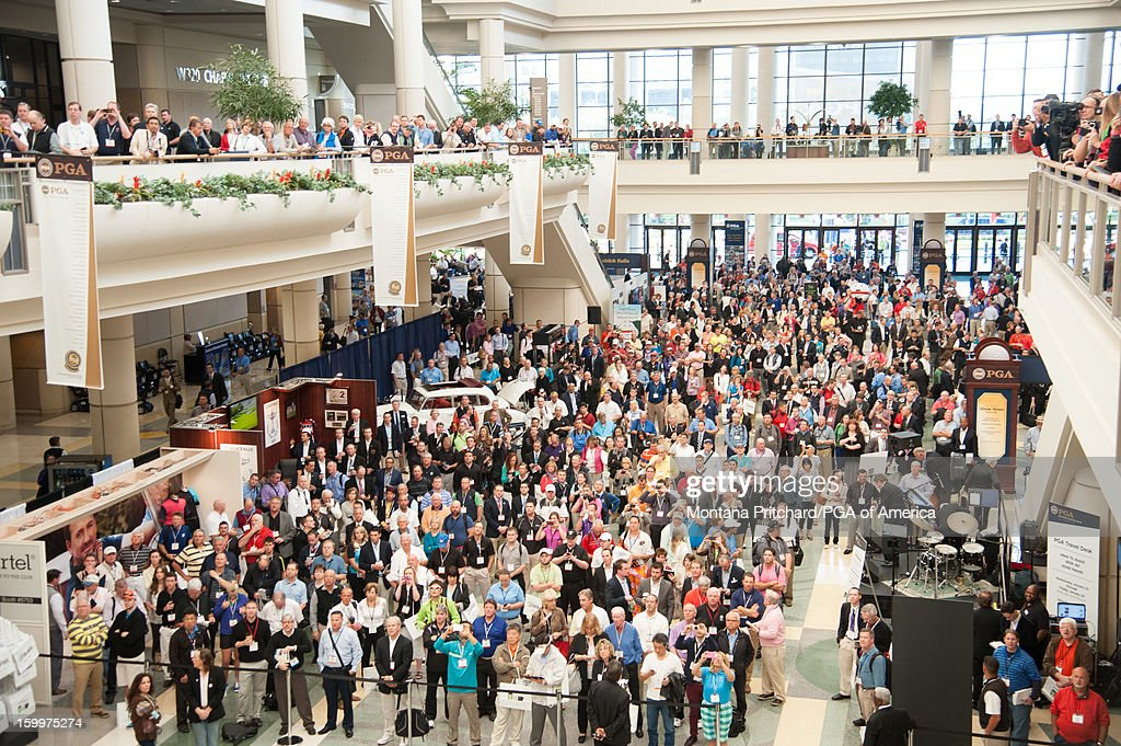 People attend the opening ceremony for the 60th PGA Merchandise Show at The Orange County Convention Center in Orlando, Florida, USA, on Thursday, January 24, 2012.
