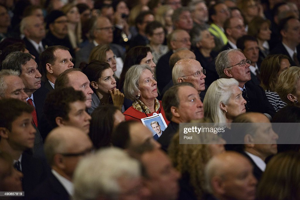 People attend the opening ceremony for the National September 11 Memorial Museum at ground zero May 15, 2014 in New York City. The museum spans seven stories, mostly underground, and contains artifacts from the attack on the World Trade Center Towers on September 11, 2001 that include the 80 ft high tridents, the so-called 'Ground Zero Cross,' the destroyed remains of Company 21's New York Fire Department Engine as well as smaller items such as letter that fell from a hijacked plane and posters of missing loved ones projected onto the wall of the museum. The museum will open to the public on May 21.