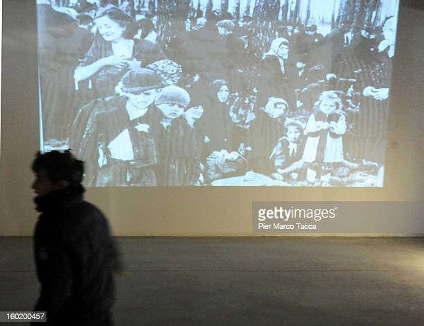 People attend the opening of 'Memoriale della Shoa' at Platform 21 which was used to transport Jews to concentration camps during World War II on...