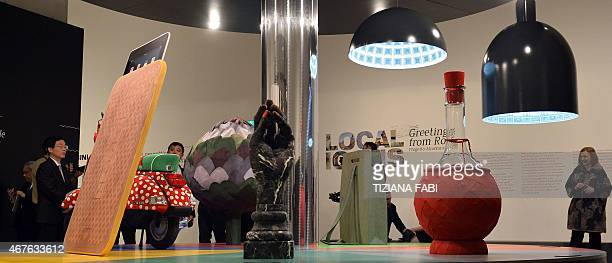 People attend the opening of the exhibition 'Local Icons Greetings from Rome' at MAXXI Museum in Rome on March 26 2015 AFP PHOTO / TIZIANA FABI...