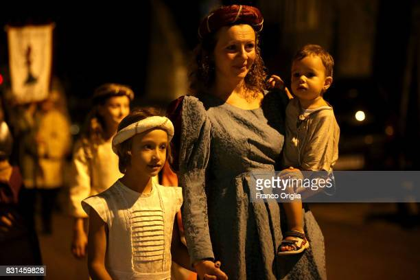 People attend the parade of the 87th Palio dei Ciuchi on August 14 2017 in Roccatederighi Grosseto Italy Palio dei Ciuchi' represents with the...