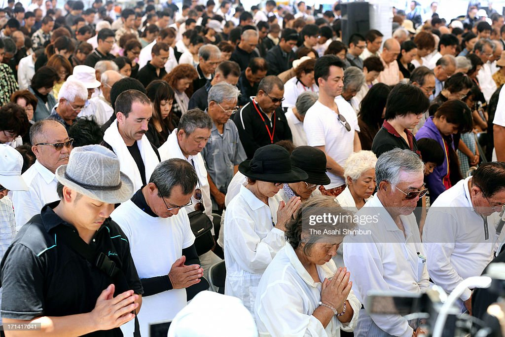 People attend the peace memorial to mark the 68th anniversary of the termination of the Battle of Okinawa at Okinawa Peace Memorial Park on June 23, 2013 in Itoman, Okinawa, Japan. During the 3-month ground battle at the end of World War II, more than 200,000 people were killed.