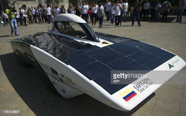 People attend the presentation of the new Solar Energy car of the EafitEpm Solar Car Team which will participate in the World Solar Challenge next 6...
