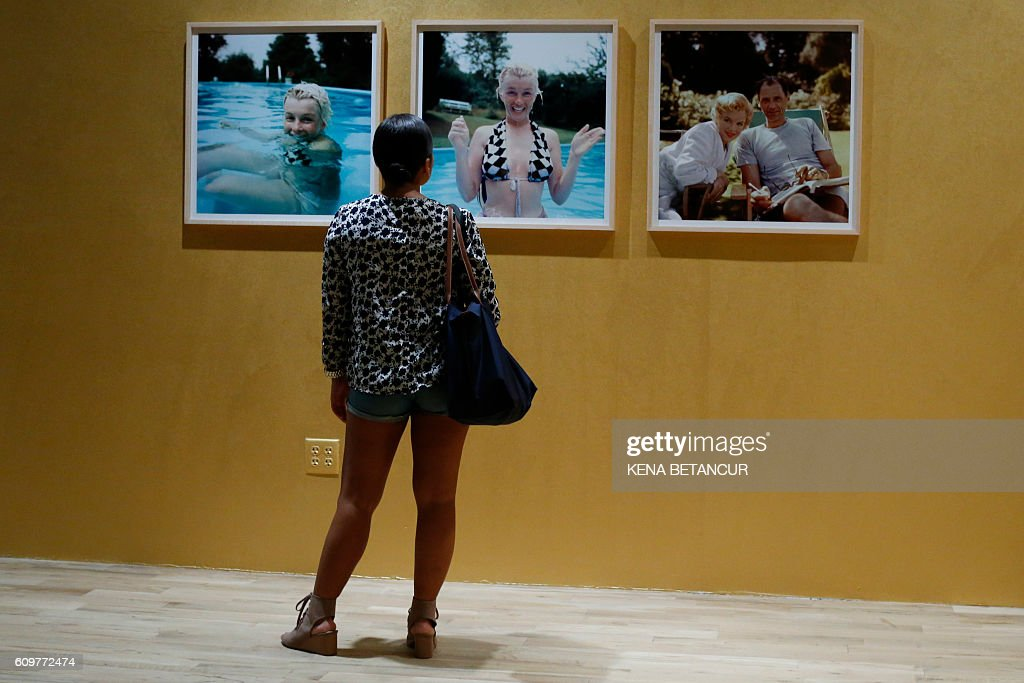 People attend the press preview for the auction for Marilyn Monroe's iconic 'Happy Birthday Mr. President' dress and other items at MANA Contemporary Museum in Jersey City, New Jersey on September 22, 2016. Julien's Auctions is offering the sequined dress for auction in Los Angeles on November 17, 2016. / AFP / KENA